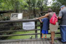 The Latest: Zoo cites break in steel cable barrier in escape