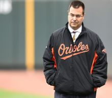 What exactly is Dan Duquette saying about Mark Trumbo, Jose Bautista and Orioles fans?