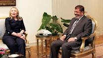 Clinton to Egypt's Morsi: Find way out of crisis