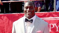 Takeo Spikes catches up with fellow athletes before the ESPYS