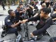 Black cops feel pain of Floyd's death, duty to their uniform