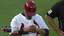 Molina injures thumb, exits game