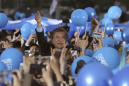 The Latest: SKorean conservative describes election as 'war'
