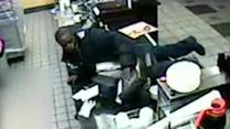 Suspect lunges on counter in 2 Philly robberies
