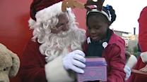 Santa travels by seaplane to deliver toys to kids