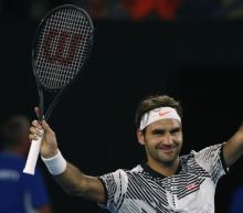 Federer makes winning return at Melbourne Park