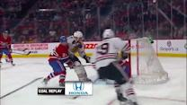 Marian Hossa chips it past Price in front