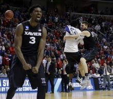 The Latest: Arizona's loss means three 2-seeds are out