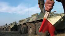 Russia pulls out battalion from near Ukraine, sends military hardware into Crimea