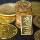 Gold gains as stocks slide on Deutsche Bank worries