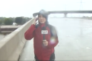 Incredible moment reporter helps rescue man caught in Harvey floods, live on TV