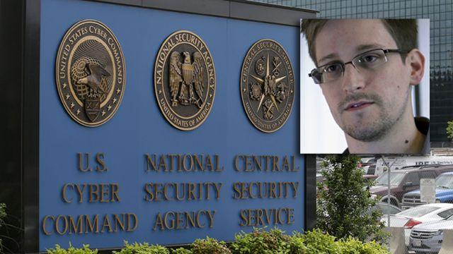How do contractors like Snowden get security clearance?