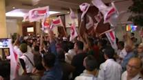 Indonesian presidential candidates both celebrate victory