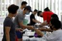 Singapore reports record new cases, quarantines 20,000 migrant workers