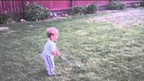 Two-Year-Old Nails Dad With Golf Swing