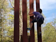 8-year-old girl scales replica of Trump's 'un-climbable' border wall in seconds