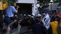Raw: Police Use Tear Gas on Protesters in Greece