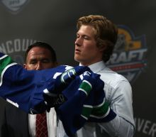 Brock Boeser signs with Canucks, will play Saturday at Wild