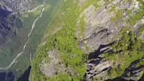 BASE jumper plunges down mountainside rockdrop