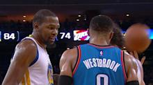 Kevin Durant and Russell Westbrook chat on the court while Steph Curry high-fives himself