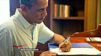 Obama breaks from vacation to sign budget, Pentagon funding bills