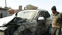 Raw: Bombings in Baghdad Area Kill Dozens