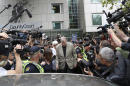 The Latest: Victim's father to sue church over Pell abuse