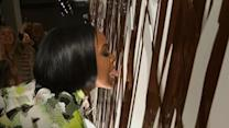 Rowland Licks Chocolate Wall at Fashion Show