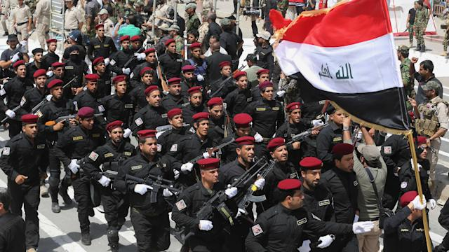 Raw: Militiamen Parade in Several Iraqi Cities