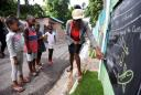 Jamaican teacher turns Kingston walls into blackboards