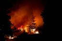 Raging wildfires destroy Washington town, roar through California, Oregon