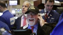 US stocks surge; Dow marks first time above 21,000 points