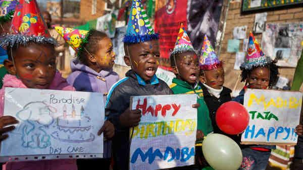 Mandela 'steadily improving' on 95th birthday