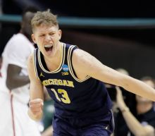 Michigan beats Louisville  continues memorable March run behind frontcourt scoring Yahoo Sports