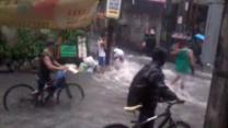Floods Cascade Along Mandaluyong City Streets as Cyclists Navigate Roads