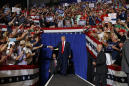 The Latest: Trump claims he was 'not happy' with chant
