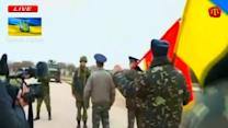 Tense standoff between Russian, Ukrainian soldiers in Crimea ends