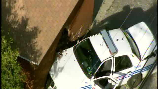 Detroit police patrol car crashes into house