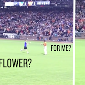 A fan ran on the field and tried to give Angel Pagan a flower. Pagan body-slammed him.