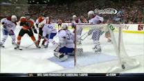 Michael Raffl chips the puck over Budaj