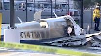 One dead, another injured after small plane crashes into parking lot