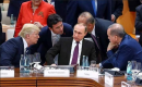 A photo of Trump and other leaders staring at Putin is going viral — but it's fake