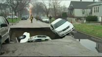 Sinkhole swallows 3 cars
