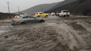 Photos: Wind, mudslides slam West Coast triggering power outages, rescues