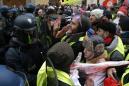 The Latest: Paris police arrest dozens during protests