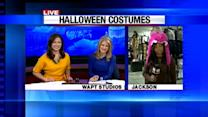 Halloween revelers make finishing touches to costumes