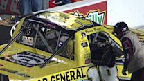 Kyle Busch's crew member jumps in the cab to check some wires