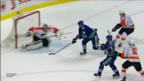 Daniel Sedin catches a break on late goal