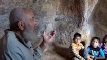 Heavy fighting forces Syrians to seek cover in caves