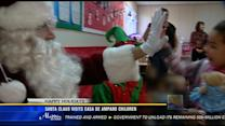 Santa Claus visits children at Casa de Amparo